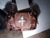 I have a huge selection of purses. Brands like Guess,