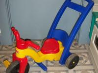 For sale is a fisher price push along tricycle. Gently