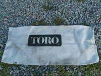 Brand new Toro heavy duty bag that goes on a push type
