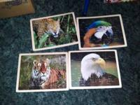I have 4 board animal puzzles 20 piece each. All for
