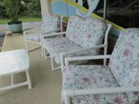 One settee, 2 chairs, 1 table with cushions.  THE