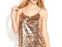 Allover sequins make this QMack tank a glam pick for