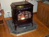 MAHOGANY PORCELAIN FINISH. INCLUDES STOVE PIPE AND