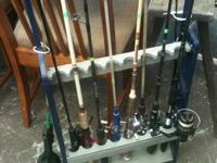 Two racks full of top quality fishing rods & reels,