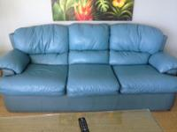 Teal leather/pleather sofa $350, lounge chair $250,
