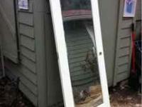 Beautiful solid wood door with mirror. Cost $475. new,