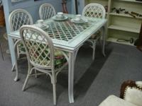 Vintage rattan table established with glass leading.