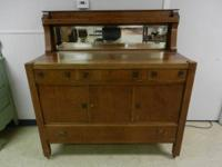 I HAVE FOR SALE A EARLY 1900's QUARTERSAWN OAK MISSION