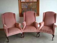 A matching set of three rose colored Queen Anne chairs