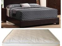Queen Faux leather bed and bed mattress set in a dark