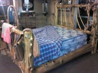 Queen hand crafted cedar bed, very unique. Asking $700,