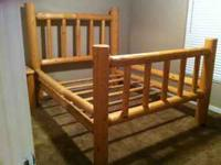 Queen log style bed frame with matching nightstand.