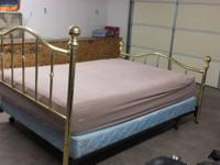 Queen brass bed with box spring and pillow top on both