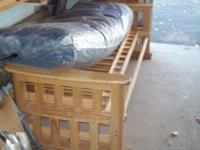 We have a queen size futon with a solid Oak frame in