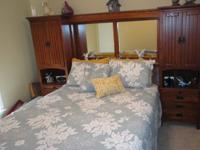 Queen size wall unit bed with dresser and mirrorWall