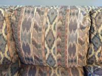 Queen sleeper sofa gently used. Material on sofa is