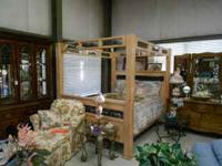We have a beautiful queen size wood canopy bed. There