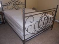 Queen Size Iron headboard and foot board plus Frame.