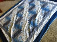 "I am selling my old quilt. 76"" X 90"". It is hand made"