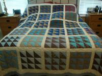 This stunning hand made queen size quilt was made with
