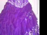 Only wore once beautiful purple dress. Pedicoat under