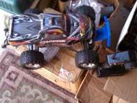 I am selling several RC trucks. These Traxxas trucks