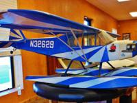 This is a vintage R/C airplane. It is a large plane,