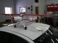 HERE IS A NEVER BEEN FLOWN 40 SIZE PIPER CUB WITH A 70""