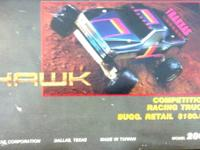 Traditional R/C auto truck TRAXXAS HAWK with brand-new