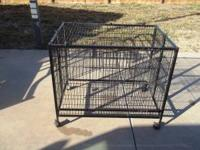 "Rolling cage for small animals in great shape. 36""W X"