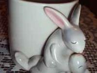 Rabbits dancing the Tango cup/vase 3.00 OR MAKE OFFER.