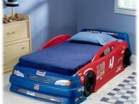 I have a race car bed im asking 100 dls phone number is