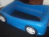 Blue race car bed with frame ...gently used..no