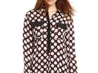 Bold print is outlined by dark trims on a blouse that