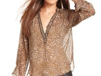 A sheer leopard print makes this RACHEL Rachel Roy top