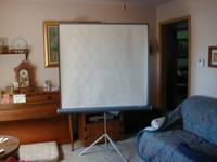 "Like new. Radiant 50"" by 50"" projector screen from the"