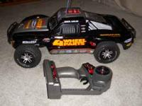 Traxxas Slash radio control car. Used for about 1 hour.