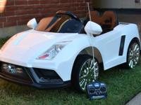 Kids White lambo Radio controlled car. They can ride in
