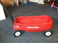 HAVE A 2 SEATER RADIO FLYER WAGON FOR SALE. ITS IN