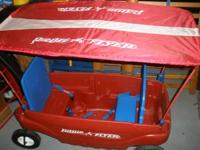 Includes (removable) canopy to keep sun out. Two seats,