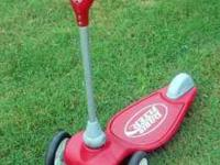 A Red Radio Flyer, My First Scooter, in good condition.