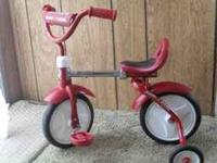 Red radio flyer adjustable tricycle $30.  Location: