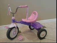 For sale is a girls Radio Flyer trike, pink and purple.