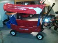 Gently used radio flyer wagon with canopy. $160 in the