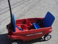 RADIO FLYER WAGON WITH FLIP UP SEATS AND SEAT BELTS IN