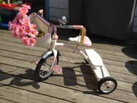White and pink Radio Flyer Trike. This was a visit play