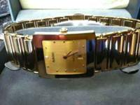 this is a Rado Diastar mid size watch. i paid 1,660 for