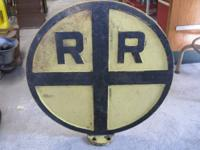 I have an uncommon antique cast iron Railroad Crossing