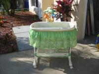 Rainforest bassinet like new condition..call  Location: