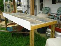 This item is a hand built raised screen table that